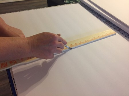 Cutting the foam core in half with an X-acto knife.