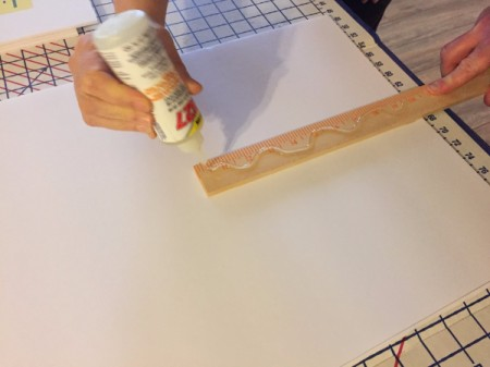 Gluing the second side of the paint stirrer.