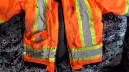 Cleaning Dirty Glazer Work Clothes - orange work jacket with stains