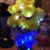 Lighted Flower Vases - lighted vase with cobalt blue lights and yellow flowers