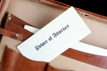 Brief case with a power of attorney in it.