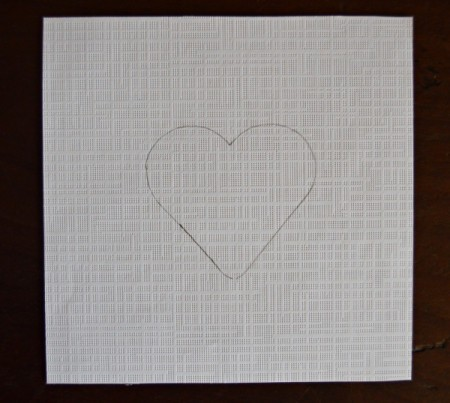 Pure Love Valentine's Day Magnetic Frame - trace a heart shape onto the white paper using a cookie cutter