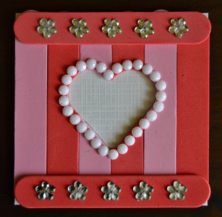 Pure Love Valentine's Day Magnetic Frame - glue 5 rhinestone flowers to the top and bottom foam sticks