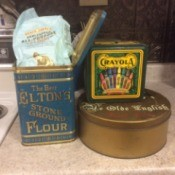 A few vintage tins being reused to store food in the kitchen.