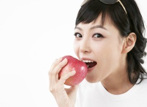 A woman eating an apple.