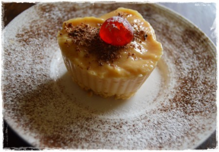 A heart shaped butterscotch pudding dessert, on a plate.