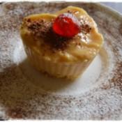 A heart shaped butterscotch pudding dessert, on a plate.