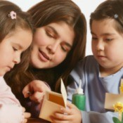 Three young people working on a Bible themed craft.