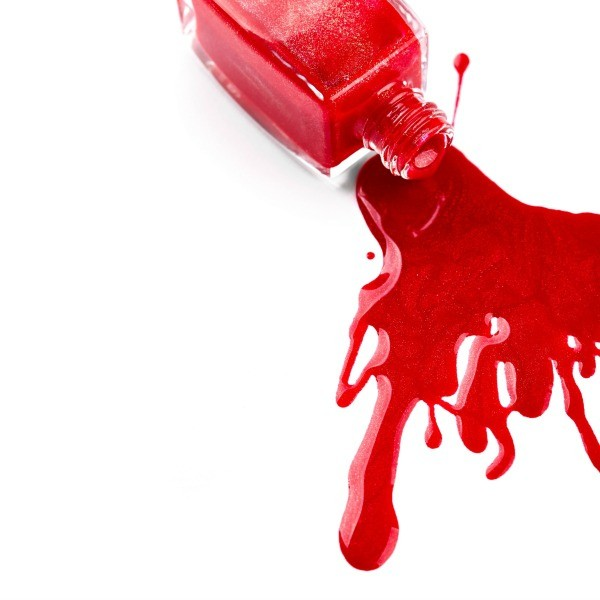 A Bottle Of Nail Polish Spilled On White Background