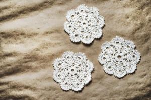 Three crocheted doilies.