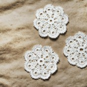 Three crocheted doilies.