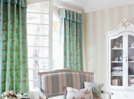 Beige walls and green curtains.