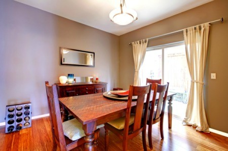 Dining room with curtains.