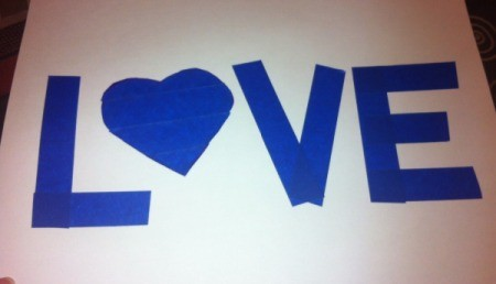 Love and Arrow Finger Paintings - cut lengths of tape to make the letters and use heart shape of the letter O