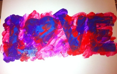 Love and Arrow Finger Paintings - apply finger paint around and up to the edge of all letters and shapes