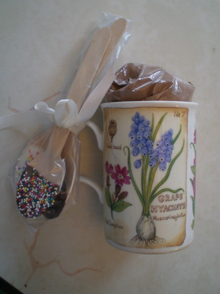 Decorated spoons tied to cup