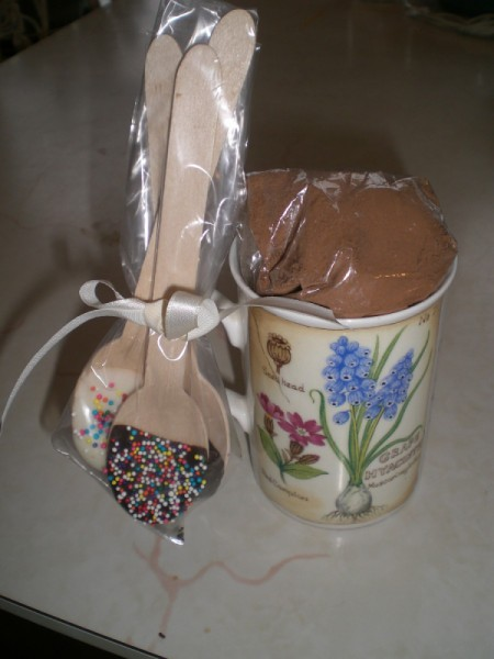 decorated chocolate spoons attached to cup