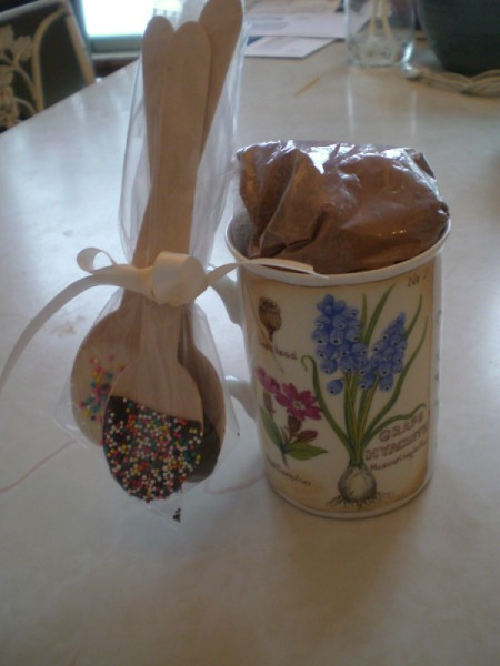 ataractic cup with decorated chocolate spoons tied to handle