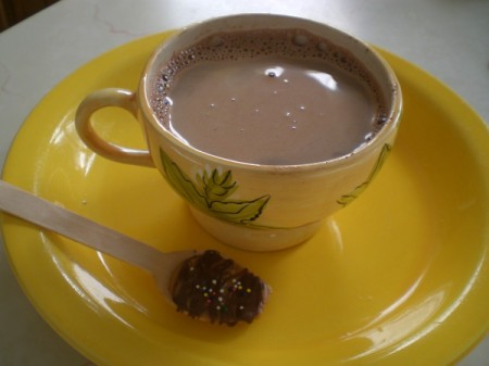 cup of cocoa with decorated spoon