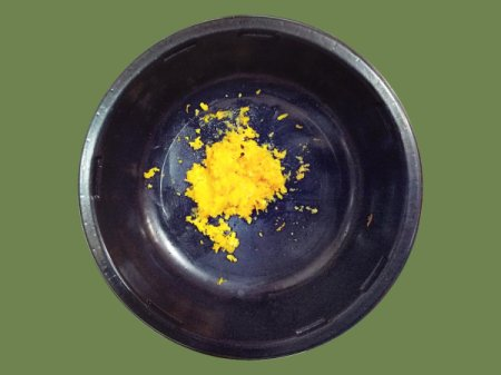 Uses For Orange Zest - small dark bowl with orange zest in bottom