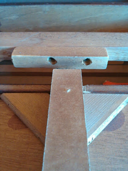 Recycled End Table as Canopy Pet Bed - removing support beam from table - closeup