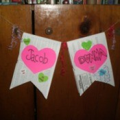 Valentine's Day Banner - two banners hanging against wall