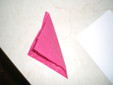 Easy Kids' Valentine Cards - fold a piece of red tissue paper on the diagonal