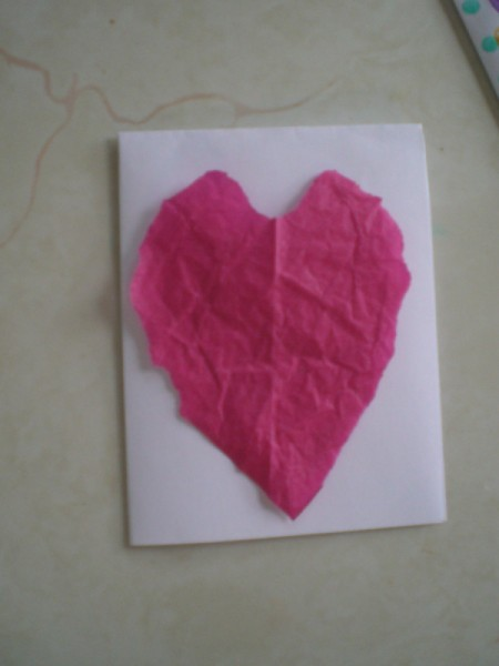 Easy Kids' Valentine Cards - placing tissue heart on card face