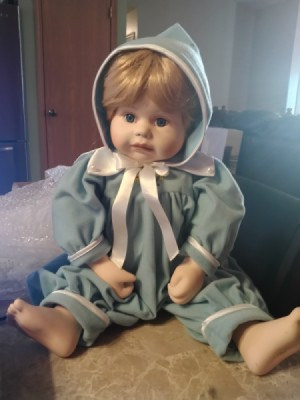 Identifying a Porcelain Doll - doll wearing one piece blue outfit with matching hat
