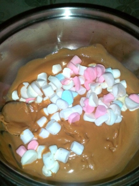 peanut butter and marshmallows in pan