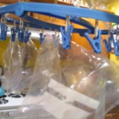 A baggie dryer with clips to hold sandwich bags.