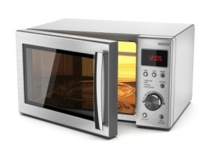 A silver microwave on a white background.