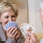A couple playing a game with cards.
