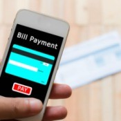 A smartphone being used to pay a bill online.