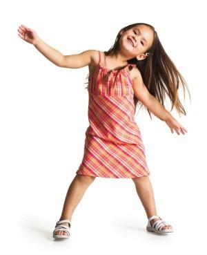 A little girl wearing a sundress.