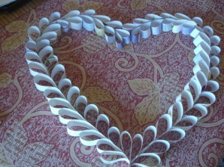 Upcycled Calendar Valentine's Heart Wreath - shape into a heart and glue the top together