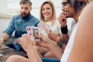 A group of friends playing a card game.