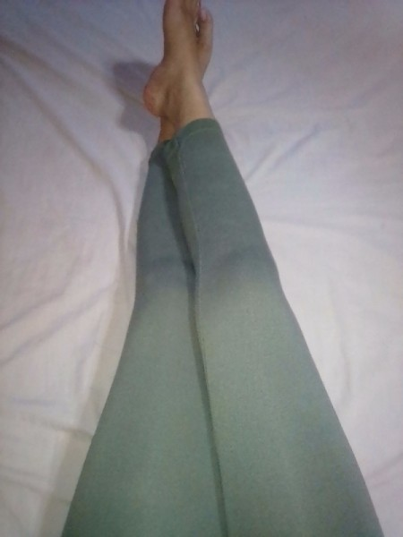Legs wearing grey leggings.