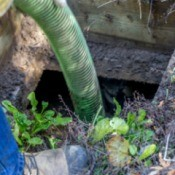 A cleaning tube in a septic tank.
