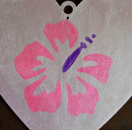 Hibiscus Love Mural Decoration - place stencil and color the leaves with the neon pink pen, and the pistil with the purple pen