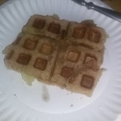 A waffle sandwich made with peanut butter and bananas.