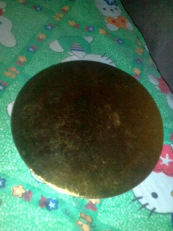 A gold colored cake plate.