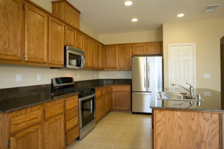 A kitchen with oak cabinets.