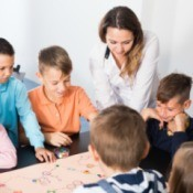 A group of children playing a board game.