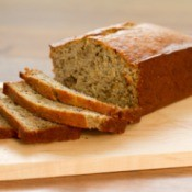 A loaf of banana bread, with thin slices.