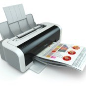 A printer printing out a color page.