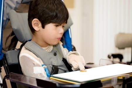 A disabled student studying in a wheelchair.