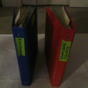 Binders with different warranties stored inside.