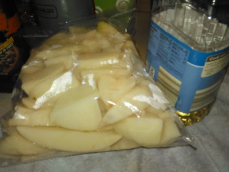 potato pieces in plastic bag with oil