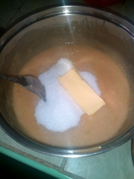 adding sugar and butter to banana mix